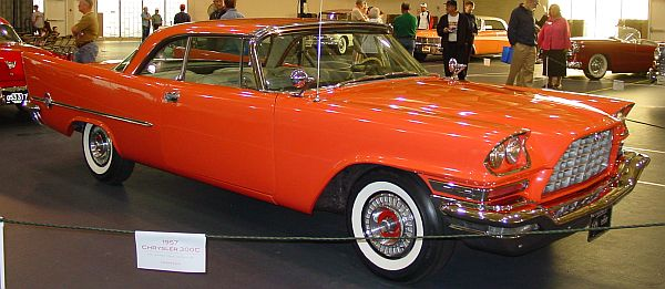 Showroom picture of red stylish car from 1957-Chrysler 300C, luxury coupe, exotic retro car